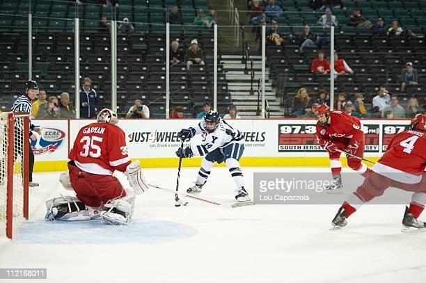 ECAC Hockey Tournament Cornell goalie Michael Garman in action vs Yale Broc Little during Championship game at Boardwalk HallAtlantic City NJ...