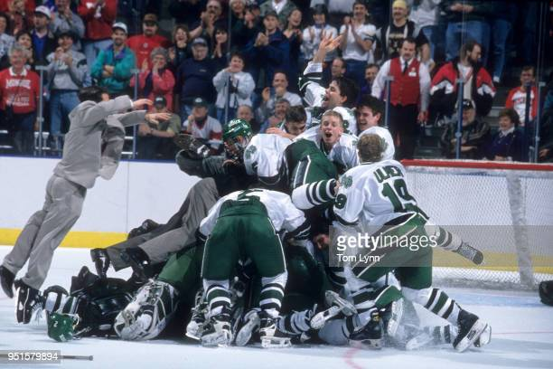 NCAA Finals North Dakota players victorious on ice after winning game vs Boston at Bradley Center Milwaukee WI CREDIT Tom Lynn