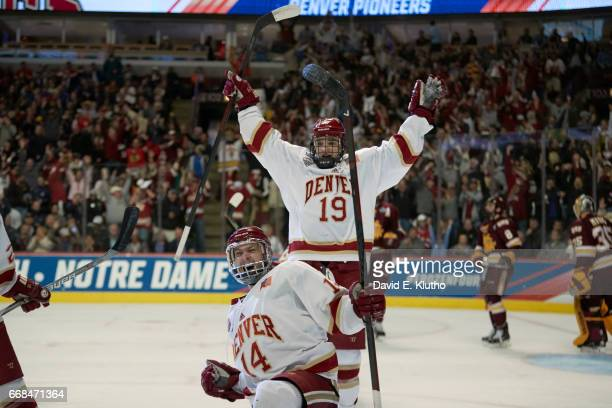 NCAA Frozen Four Denver Jarid Lukosevicius victorious after scoring second goal with Troy Terry vs Minnesota Duluth at United Center Chicago IL...