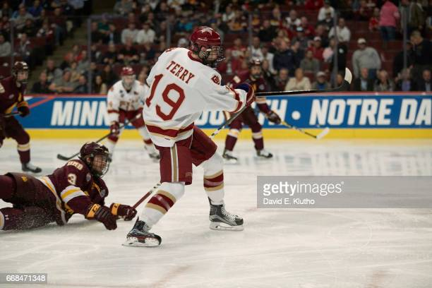 NCAA Frozen Four Denver Troy Terry in action shooting vs Minnesota Duluth Dan Molenaar at United Center Chicago IL CREDIT David E Klutho