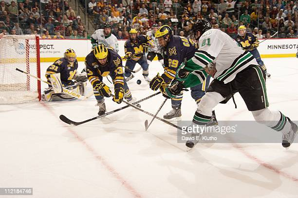 NCAA Frozen Four Michigan Lee Moffie Louis Caporusso in action vs North Dakota Matt Frattin during National Semifinals game at Xcel Energy CenterSt...
