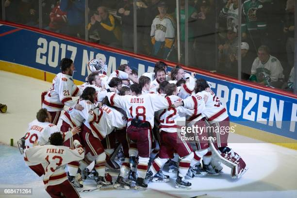 NCAA Frozen Four of Denver goalie Tanner Jaillet victorious with teammates on ice after winning game vs Minnesota Duluth at United Center Chicago IL...