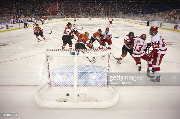 NCAA Frozen Four Wisconsin Jordy Murray in action scoring goal vs Rochester Institute of Technology goalie Jared DeMichiel at Ford Field Detroit MI...