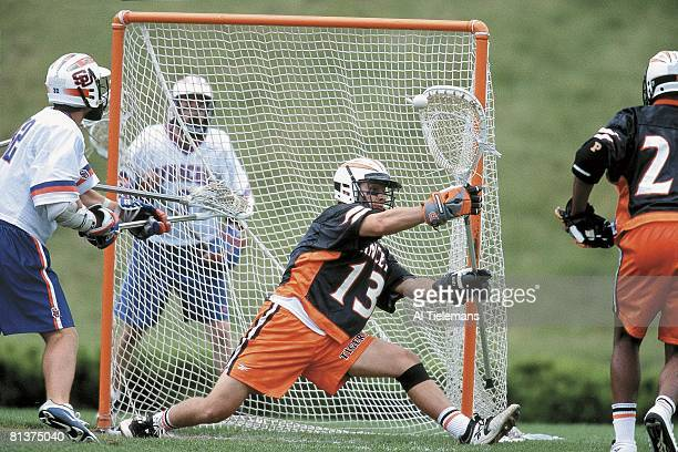 College Lacrosse NCAA championships Princeton goalie Trevor Tierney in action making save vs Syracuse New Brunswick NJ 5/28/2001