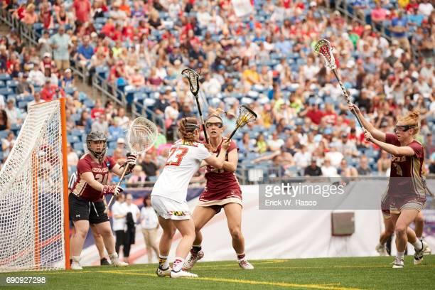 NCAA Finals Boston College goalie Lauren Daly Kate Taylor and Elizabeth Miller in action defense vs University of Maryland Megan Whittle during game...