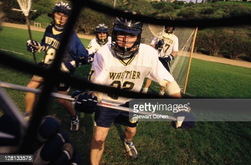 College lacrosse seen through player's helmet