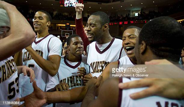 College of Charleston players celebrate their 8279 overtime victory over North Carolina on Monday January 4 at Carolina First Arena in Charleston...