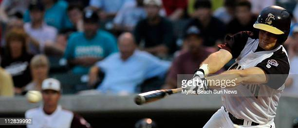 College of Charleston second baseman Joey Bergman connects on an RBI single in the fourth inning against North Carolina State during the second game...