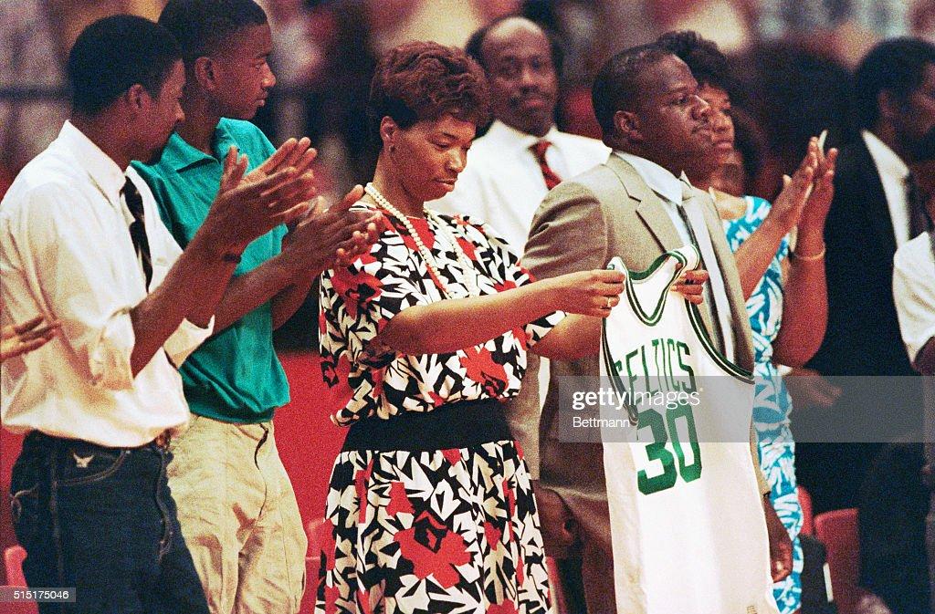 reputable site da7d7 e7338 Lonise Bias, mother of Len Bias, holds a Boston Celtics ...