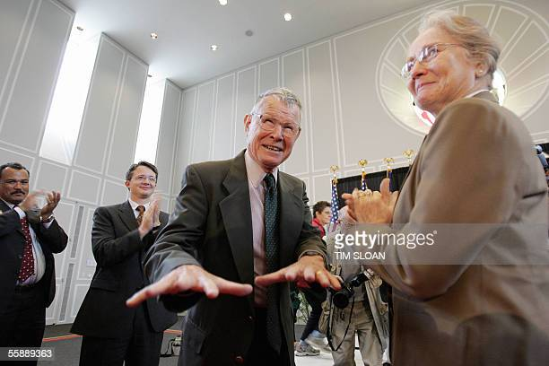 University of Maryland economist Thomas C Schelling acknowledges applause as his wife Alice looks on at the University of Maryland in College Park...