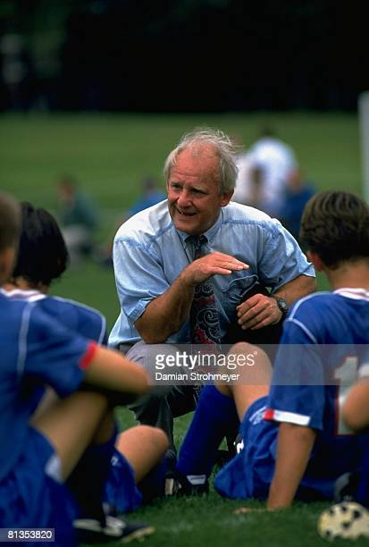 College Soccer: Connecticut College coach Ken Kline with team during game vs Amherst College, Amherst, MA 9/24/1994