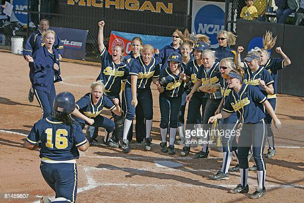 College Softball NCAA playoffs Michigan Samantha Findlay in action scoring run after hitting HR Washington Team victorious at home plate Ann Arbor MI...