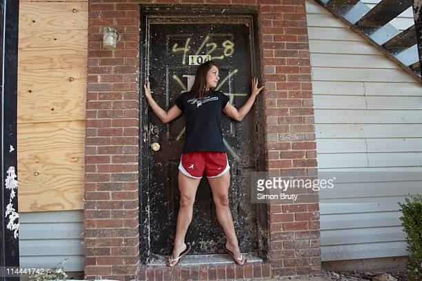 Tuscaloosa Tornado Portrait of University of Alabama gymnastics athlete Kayla Hoffman during photo shoot in the door frame of the first floor...
