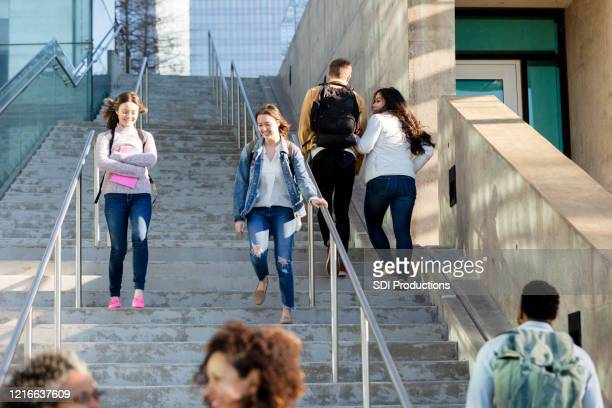 college student descent outdoor staircase - community college stock pictures, royalty-free photos & images