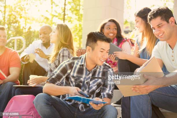 college student friends study together on university campus. - minority groups stock pictures, royalty-free photos & images