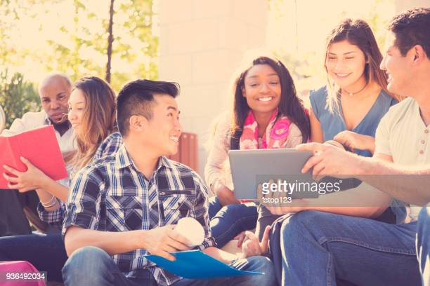 College student friends study together on university campus.