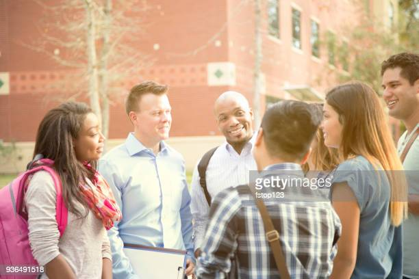 College student friends talk together on university campus.