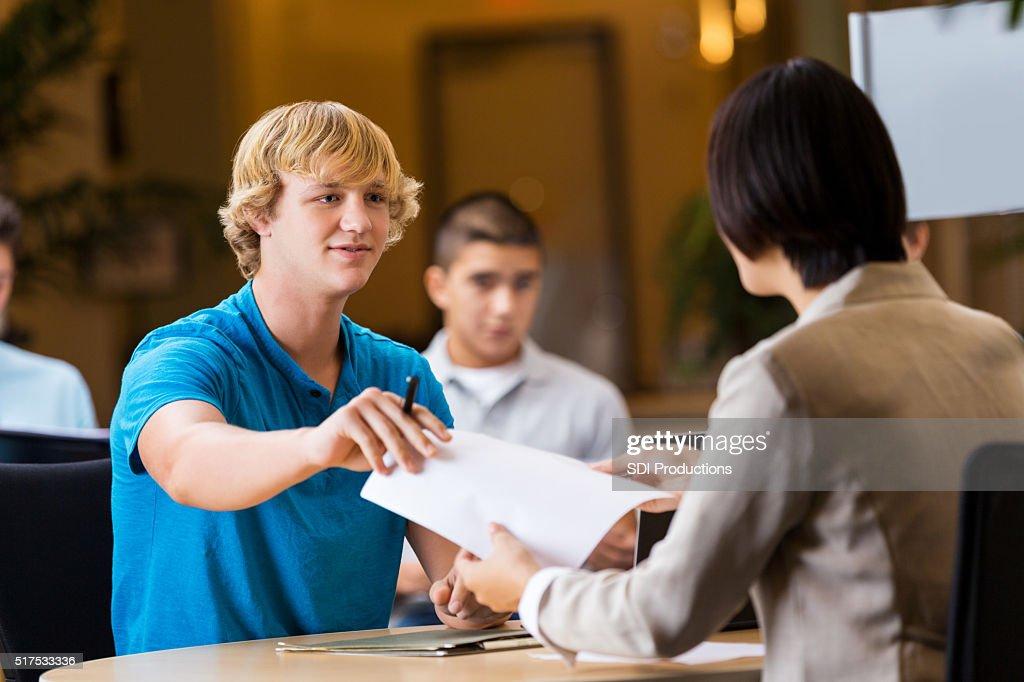 College student interviews at job fair : Stock Photo