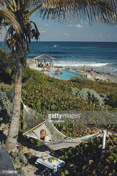 College student Jan Woods relaxes in a hammock at the Abaco Inn on Elbow Cay one of the Abaco Islands in the Bahamas March 1986