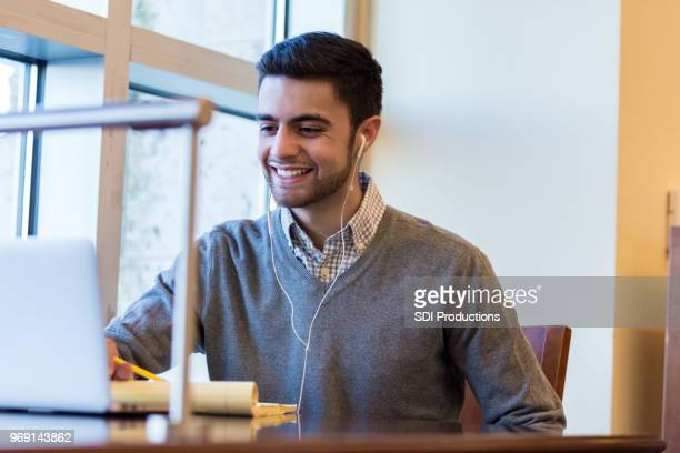 College student listens to music while studying