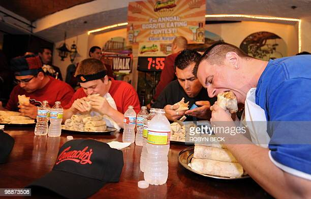 College student Lucas Bennett races through a platter of burritos to win the second annual Burrito Bowl in celebration of Cinco de Mayo at Universal...