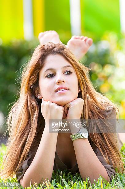 college student lying on the grass - teen soles stock photos and pictures
