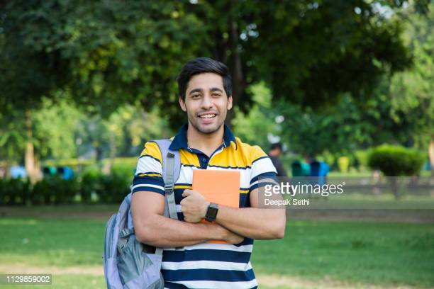 college student outdoor - stock image - person in education stock pictures, royalty-free photos & images
