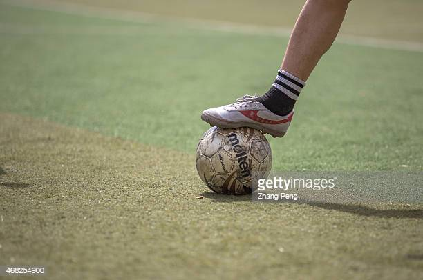 A college student plays in a football game in campus on a Sunday afternoon China has issued a football reform plan to boost the development of the...