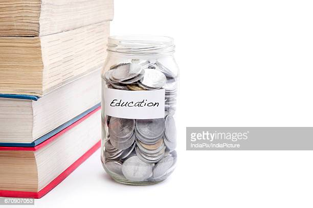 College student savings money in a jar for education