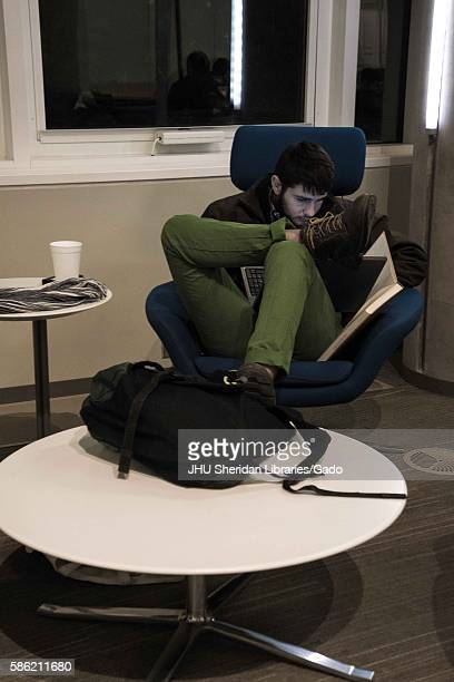 College student studies late at night in the Brody Learning Commons, a library and study space on the Homewood campus of the Johns Hopkins University...