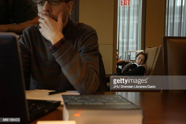 College student takes a break from studying with a nap as her peers study in the Reading Room of the Brody Learning Commons, a study space and...