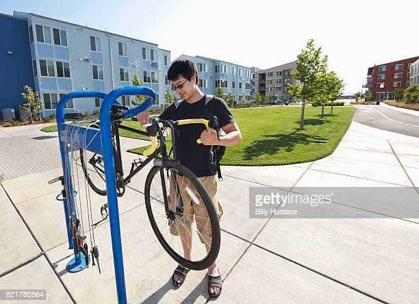 College student using a bicycle repair station, in a Zero Net Energy community
