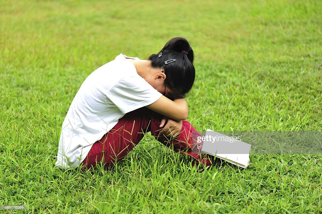 college student with book sit on green grass : Stock Photo