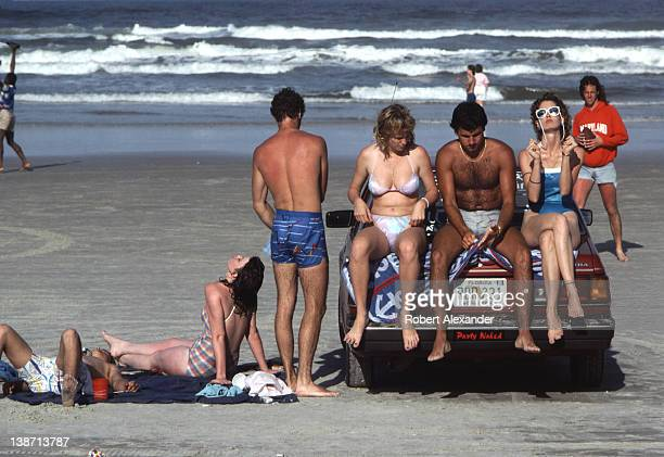 College students and other teenagers enjoy the sun and beach during Spring Break at Daytona Beach Florida a popular Spring Break destination for...
