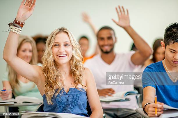 College Students Answering Questions in Class