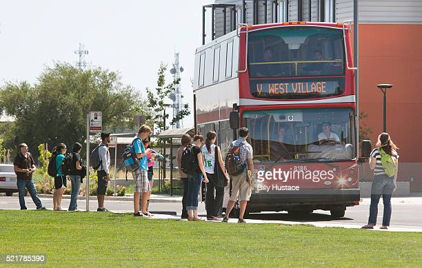 College students boarding a campus bus, in a Zero Net Energy community