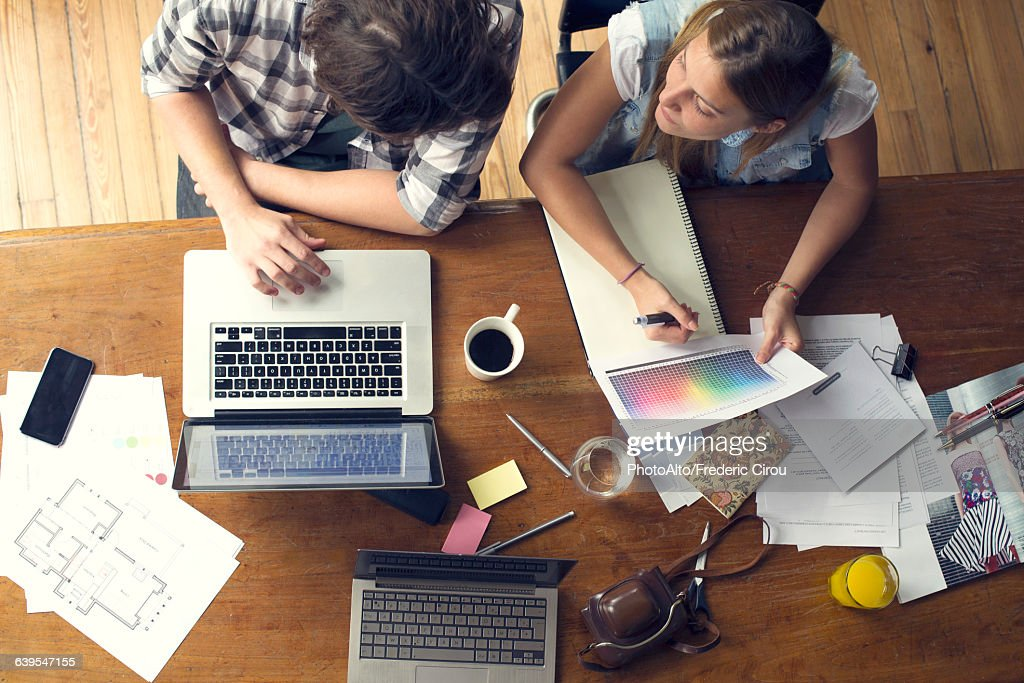 College students collaborating on project : Stock Photo