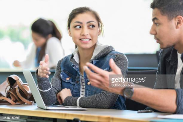 college students debate topic before class - debate stock pictures, royalty-free photos & images