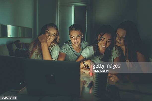 College students doing homework together at home