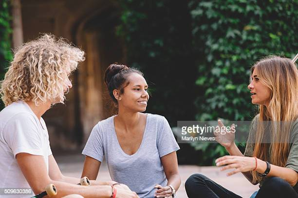 college students having a conversation - university stock pictures, royalty-free photos & images