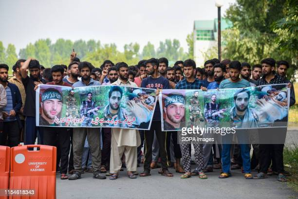 College Students hold banners during a protest in Srinagar A complete shutdown is being observed across Kashmir during a third death anniversary of...