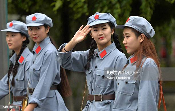 College students in Red Army costumes walk to a show to celebrate the 95th anniversary of the Communist Party of China on June 29, 2016 in Shenyang,...