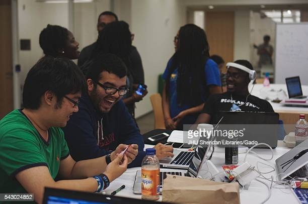 College students laugh and talk as they study in the Brody Learning Commons, a study space and library on the Homewood campus of Johns Hopkins...
