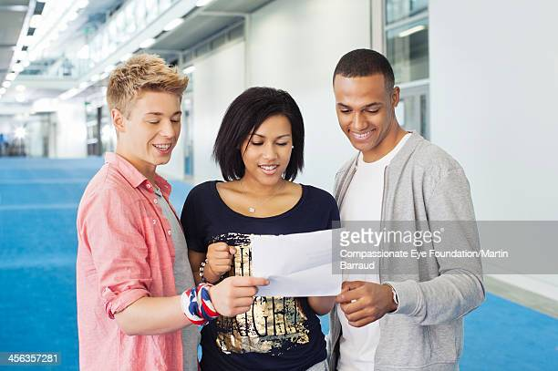 college students looking at test results - day stock pictures, royalty-free photos & images