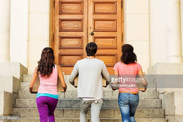 college students moving into dormitory - day of doors stock pictures, royalty-free photos & images