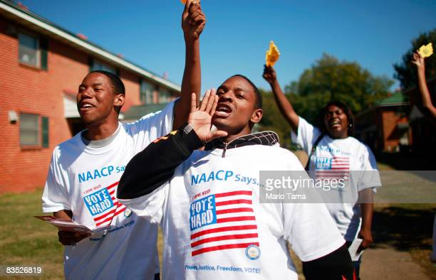 College students on the NAACP's Vote Hard bus tour encourage people to vote in the George Washington Carver Homes housing project next to the...