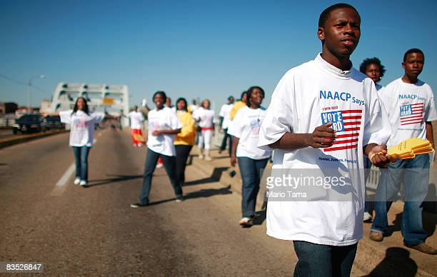 College students on the NAACP's Vote Hard bus tour walk across the historic Edmund Pettis Bridge November 1 2008 in Selma Alabama The bridge was...
