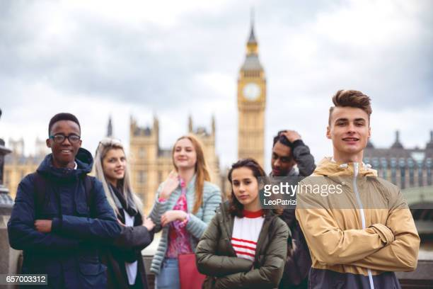 college students on travel to london - houses of parliament london stock photos and pictures