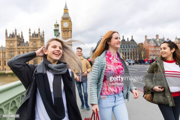college students on travel to london - city of westminster london stock photos and pictures
