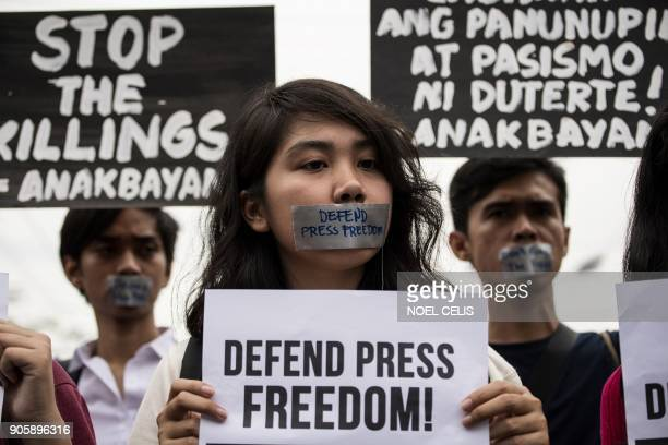 College students participate in a protest to defend press freedom in Manila on January 17 2018 Philippine President Rodrigo Duterte's government on...